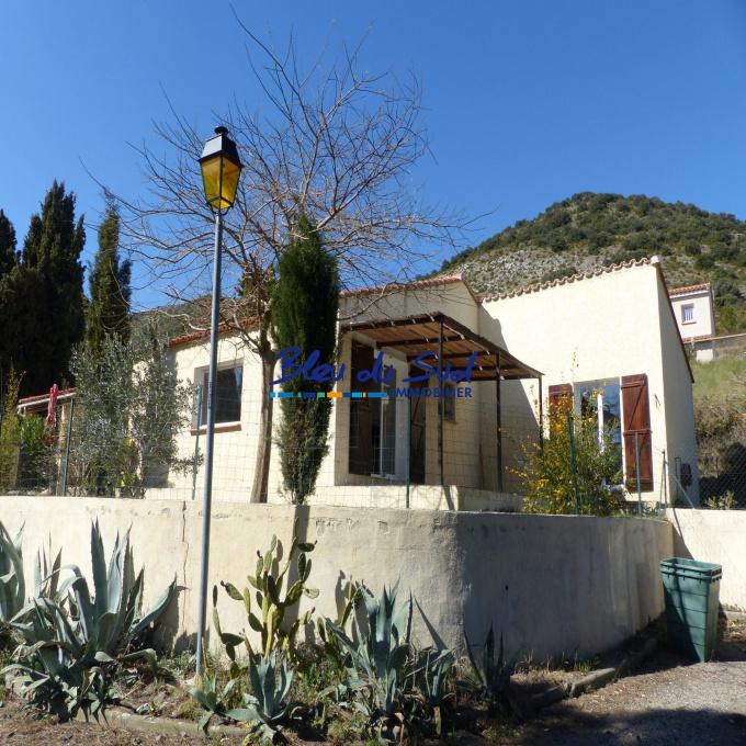 Maison de plain pied avec mezzanine et jardin